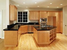 black counter tops, and wood floors with the light cabinets is what we are wanting  in our kitchen