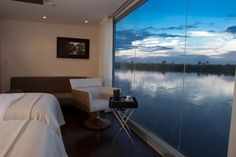 the view from within the aqua expeditions boat by architect jordi puig, amazon river, peru