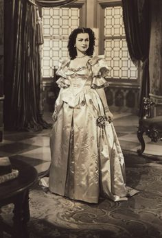 petal pink satin period costume gown worn by Joan Bennett as Princess Maria Theresa in the film 'The Man in the Iron Mask' (United Artists, 1939).