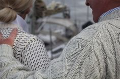 Like his sweater, but love that Norwegian sweater she has on.