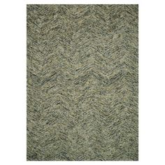New Zealand wool rug with a textured diamonds motif. Hand-tufted in India.   Product: RugConstruction Material:
