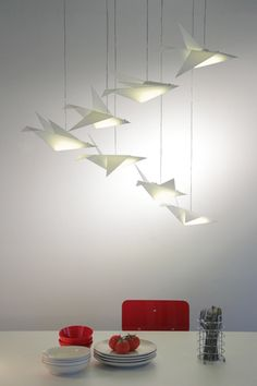 Migration: Migration is a led ceiling lamp that follows the Origamis Hunter collection. The main element is the bird, constructed following the principles of the origami technique and pleated paper. They are made of opaque acrylic and each one contains a led plate particularly designed and manufactured. | Si Studio, Chile