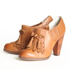"Seychelles Clue Oxford Heels In Whiskey 129.99 at shopruche.com. Enticing kiltie fringe fronts this traditional-style oxford, which is elevated with a thick stacked heel. Slip-on style with elasticized sides.  Leather upper  Man-made sole 4"" heel Slightly cushioned footbed"