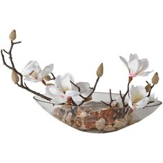 Faux white magnolias in clear bowl.      Product: Faux floral arrangement    Construction Material: Fabric, acrylic an...