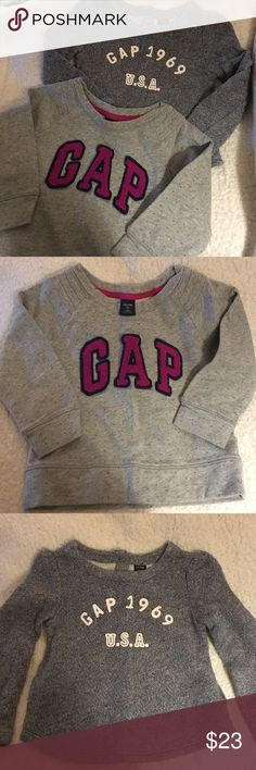 EUC - Bundle of 2 GAP Sweatshirts Excellent used condition. Worn only once or twice, two adorable GAP sweatshirts for your little girl! Both Size 2T. One is light gray with pink polka dots and pink fuzzy GAP emblem on the front. The second is navy blue with the GAP 1969 USA emblem on front. It has two buttons up the back. Both are soft, comfy, and in like-new condition! Check out my closet to bundle and save! GAP Shirts & Tops