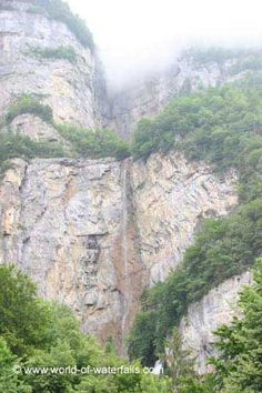 Looking up towards the third tier of Seerenbach Falls with only a small bit of the 2nd tier visible as it was mostly obscured by clouds, Weesen / Walensee, St Gallen Canton, Switzerland