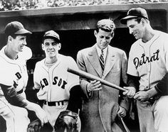 Ted Williams, Eddie Pellagrini, John F. Kennedy, and Hank Greenberg talk baseball prior to a Red Sox game at Fenway Park in 1946. The 29-year-old Kennedy was campaigning for a congressional seat. (AP)