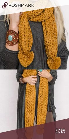 """Mustard Pom Knit Scarf The most adorable knitted scarf. Extra long for versatility while wearing it, plus, cute yarn pom poms at the ends!   100% Acrylic  Size 80""""x10"""" Accessories Scarves & Wraps"""