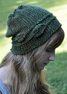 This hat is knitted sideways in garter stitch. The lines are drawn by slip stitches with two leaves circling around your head like a headband.