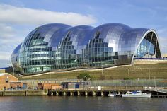 The Sage, a center for musical performances and conferences, is famous for the curving of glass and stainless steel. It is located in the city of Gateshead in England.
