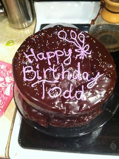Triple layer, dark chocolate cake with homemade frosting