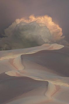 Sand dunes and cloud.