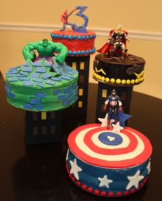 Super Hero - It is my Nephews third birthday and he couldn't decide which hero he liked best, so I made a cake for each one.  Everything is edible except for the sky scrapers made from foam core and of course the action figures that I was told were a requirement.  The ideas for the cake came from a combination of cakes I find on cake central, Thank-you!
