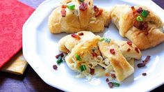 Crescent rolls stuffed with cheese, chicken, buffalo sauce, cream cheese and bacon are a perfect appetizer for parties or game day.