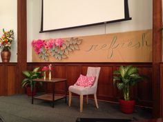 Stage decoration for women's winter conference. Used dollar store flowers, tissue paper flowers and spray painted construction paper. All hot glued on. Church Interior Design, Church Stage Design, Retreat Gifts, Women's Retreat, Youth Group Rooms, Womens Ministry Events, 2017 Decor, Altar Design, Church Events