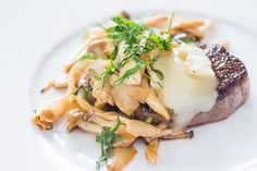 """Steak with brie and mushrooms: """"The brie melts all over the top of the steak giving it a creamy sauce that's simply divine with the earthy sautéed mushrooms. The wine deglazes the pan, releasing all the beef flavor caramelized to the bottom of the pan. Then it reduces down, coating each mushroom in a tangy flavorful glaze that balances the rich creamy cheese underneath."""""""