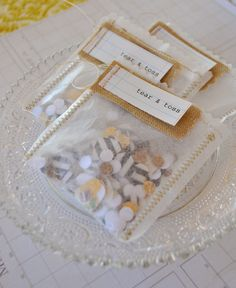 Rustic DIY bride and groom wedding ceremony toss bags. Just sewn wax paper w/ burlap trim. EASY and can be filled with anything!