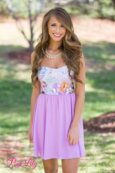 You'll adore this sweet strapless dress on summer evenings! The soft material of this dress and the flowing purple skirt add a touch of romance, while the pattern featuring purple, orange, white, and yellow flowers will stand out in a crowd!