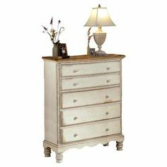 """Crafted of New Zealand pine wood, this charming 5-drawer chest pairs a hand-rubbed, antiqued white finish with carved twist detailing and a scalloped apron.  Product: Chest   Construction Material: New Zealand pine wood    Color: Antiqued white    Features: Five drawers  Hand-rubbed finish      Dimensions: 54"""" H x 42"""" W x 20"""" D       Cleaning and Care: Dust frequently.  Do not use liquid or abrasive cleaners as they may damage the finish."""