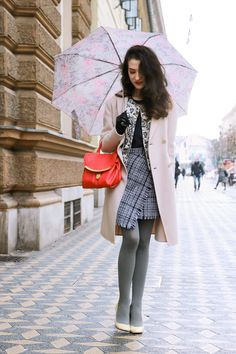 Fashion blogger Veronika Lipar of Brunette From Wall Street wearing black and white Storets tweed skirt, floral bomber jacket, fishnet stockings white pumps and pink See by Chloè bag