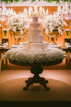 White Flowers and a white cake create a simple and elegant look whilst the full gypsophellia adds to the romance. #whitewedding #weddingcake #gypsophellia
