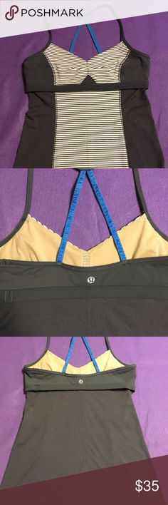"""Lululemon Bend and Flow Tank Size 8 EUC Gray Lululemon Bend and Flow Tank in EUC. Dark Gray with Cornflower Blue straps. Mark on interior.  Shelf bra, no pads.  No size tag, but based on how it fit me it is an 8.  Total length about 27"""" 15"""" pit to pit  bra-outside design makes it easy to get this tank on and off  thin, stretchy straps help keep your tank in place  designed with pockets for removable cups  Luon Light, Mesh  coverage: medium  fit: slim  length: hip lululemon athletica Tops…"""