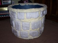 ... I decided to work on a faux well for a Samara/The Ring static prop for '08. I used a large round storage container from Wal-Mart as the supporting structure, I made the stones from styrofoam and filled in the gaps with great stuff and carved it down. Here's what I have so far...I still have to add a layer of monster mud, paint the stones and build the armature for Samara.