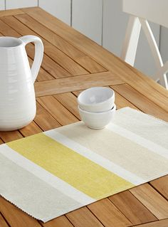 Designed in our studios exclusively for Simons Maison     This season's fashionable colour, a beautiful bright accent yellow, arranged in block stripes with grey and beige for a very trendy interpretation in home decor.    Soft 100% cotton weave   Easy machine-care   33 x 50 cm