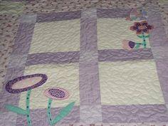 tampo em patchwork, manta de fibra e forro, quilt, bordado em aplicação  várias estampas  essa estampa da foto é ilustrativa, podemos não ter mais essa mesma,  mas sempre usaremos tecidos que dão o mesmo efeito visual.