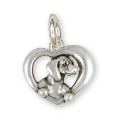 Completely solid and fully dimensional, our dachshund in a heart charm is incredibly detailed, unique and full of personality.  This is also available in solid 14k yellow gold and gold vermeil.