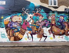 Here's an old Christmas piece by @captainkris @spzero76 @si_mitchell AKA #LostSouls in #Camden! -- What says Christmas more than skulls Llamas and sunglasses...love it!    -- #globalstreetart #streetart #art #christmas #christmastime #wallart #urbanart
