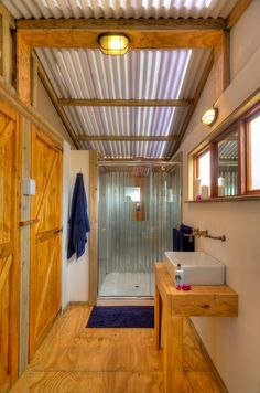 New shower design at AfriCamps Glamping at Kam'Bati, South Africa. AfriCamps Glamping at Kam'Bati is situated on an Overberg farm about 20km west of Swellendam in South Africa. The Sonderend River and Breede River meet on the property and our 5 luxury Boutique Camping tents are located in a beautiful and quiet patch of forest close to the river.