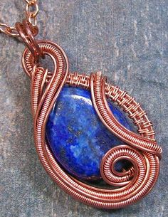 Lapis Lazuli And Copper Sculpted Coil Pendant Photograph - Lapis Lazuli And Copper Sculpted Coil Pendant Fine Art Print