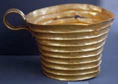 Mycenae in Greece Gold cup with horizontal ribs from Grave Circle A at Mycenae; museum inventory number 392.