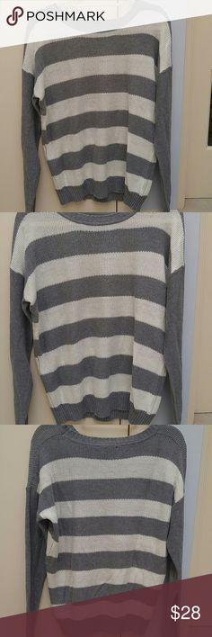 Striped Cotton Sweater Forever 21 Size Medium. Sleeves are gray, the front and back of the sweater is gray and cream horizontal stripes. 58% Acrylic 42% Cotton. Brand New Condition.  *If you purchase ANY 2 ITEMS from my closet, add them to a bundle and RECEIVE 5% OFF entire purchase!! PLUS...you ONLY PAY 1 Shipping Price!! Fast shipper!!! Forever 21 Tops