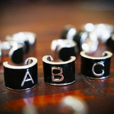 Gloss Monogram - Single initial charms, embossed over a matte black gloss finish.