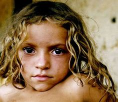 BrazilThis girl is very poor in North East Brazil; I was traveling around there when I saw this girl looking at me with those eyes; so I took the shot; I will be back to Brazil and revisit her house to give herthis photo.