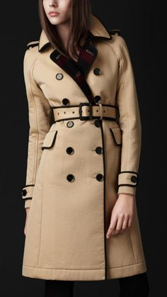 Heritage cotton gabardine trench coat with contrast bound-edges  Horn buttons engraved with the Burberry Prorsum logo  Lined with warm wool in iconic check  Gabardine-bound epaulettes, belted waist and tab-button cuffs  Fitted raglan sleeve and tapered waist enhance the feminine silhouette  Hook-and-eye collar, flap pockets  Centre vent    BUT IT'S VERY UNCOMFORTABLE TO WEAR..((