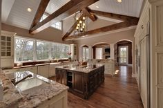 I think I have a 'thing' for beams in kitchens now... very pretty kitchen with a nice view! Would like a view of the family room though...