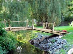 DIY suspension bridge construction useing wood | was told by a friend that sells fences and bridges that this would ...