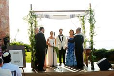 The bride and groom exchanged vows in a traditional Jewish ceremony led by the groom's rabbis. The chuppah was composed of greenery and ivory petals, and the tallit used belonged to the bride's grandfather – a Holocaust survivor. #weddingceremony #decor Photography: Paul Barnett Photographer. Read More: http://www.insideweddings.com/weddings/oceanfront-ceremony-sunset-reception-in-puerto-vallarta-mexico/576/