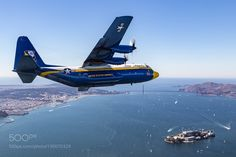 "http://500px.com/photo/190070329 Banking On The Bay by EmmanuelCanaan -The U.S. Navy and Marine Corps C-130 ""Fat Albert"" banks high above the Golden Gate Bridge and Alcatraz Island in preparation to drop the U.S. Navy Parachute Team ""The Leap Frogs"" at the start of San Francisco Fleet Week's Friday air show.  Photo ship pilot: Sean D. Tucker  Please consider voting for this image in the Air & Space photo contest at…"