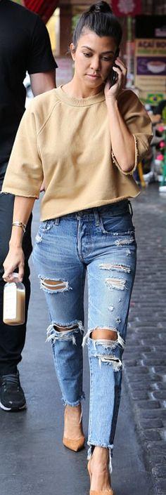 Kourtney Kardashian in Sweatshirt – Visitor on Earth  Jeans – Good American  Shoes – Gianvito Rossi  Bracelet – Cartier