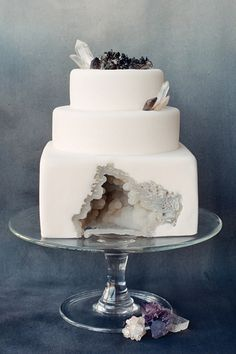 This almost icy-looking fondant covered geode wedding cake was inspired by the Oregon coast and is not entirely edible. (Hint: Those are real geodes and crystals on top.)