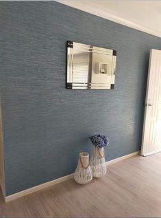 This teal grasscloth textured design featuring mica adds a beautiful shine and looks just gorgeous in our client's entrance way! #grassclothwallpaper #tealwallpaper #texturedwallpaper Teal Wallpaper, Textured Wallpaper, Entrance Ways, Empty Spaces, Texture Design, Floating Nightstand, Furniture, Beautiful, Home Decor