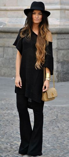 Create long lines in an oversized t-shirt and striking flared pants.