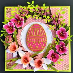 Susan Tierney-Cockburn creates a colorful Easter card with Joset Designs' Easter Egg (die cut from Premium Palette Cherry) layered onto a Stitched Circle from Els van de Burgt Studio. Susan frames the egg with her Garden Notes: Grapevine Wreath Circle; Daffodil; and Pansy. Susan adds to the wreath's foliage with branches from CountryScapes Woods 1 and Els's Leafy Branch (die cut from Premium Palette Spring Green). Shop Susan's products on our website: http://www.elizabethcraftdesigns.com/
