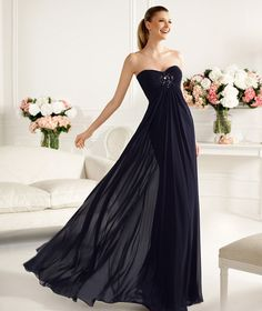 Pronovias presents the Candida cocktail dress from the 2013 Long collection. Black bridesmaids dress