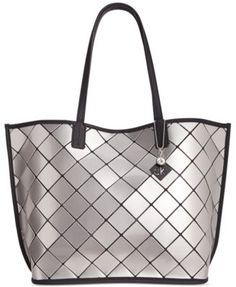 Calvin Klein Geo Patent Tote $111.00 Sleek, chic and effortless. This eye-catching tote from Calvin Klein is sure to turn heads at the office or out on the weekend.
