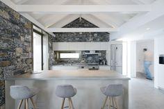 Villa Melana contemporary country house in Tyros, Greece by Panagiotis Papassotiriou / kitchen